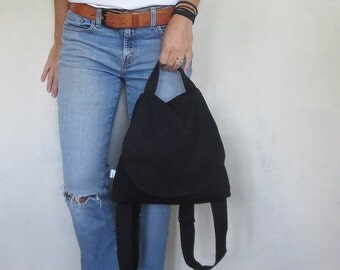 Black backpack purse. medium backpack in black fabric with adjustable straps and snap flap. choose interior color.