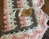 Gray, white, and pink blanket
