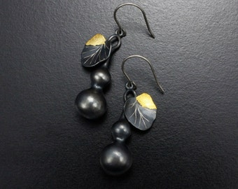 Gourd earrings of patinaed silver  with fine gold leaf