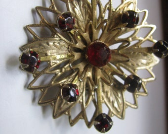Beautiful filigree pin prong set with deep red glass stones