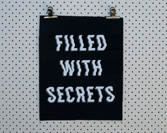 Filled with Secrets Back Patch screen printed black canvas