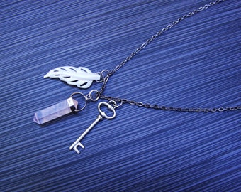Lucky talisman necklace sterling rset rose quartz point, carved mother of pearl, and silver skeletons key charm on gunmetal chain