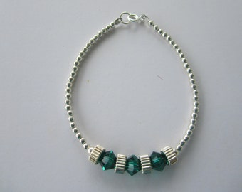 Sterling Silver Bracelet with Green Swarovski Crystals Between Sterling Silver Rounds