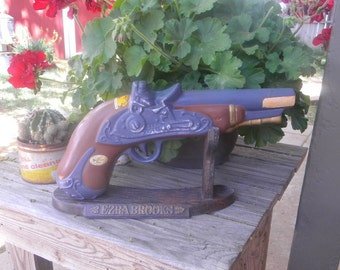 Ezra Brooks gun decanter on stand vintage 1969 Kansas tax sticker