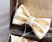 Gold bow-tie and pocket square sets.