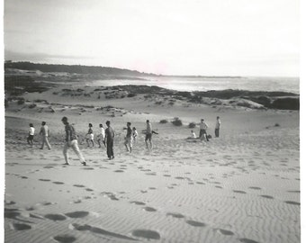 "Vintage Photo ""Like Lemmings"" Large Group of People Trek Across A Beach - 1960's Black & White Snapshot - Found Vernacular"
