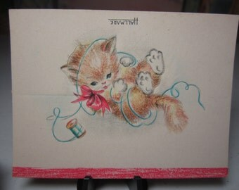 Adorable unused die cut 1940's Hallmark place card kitten playing with and wrapped up in a spool of thread wearing pink bow