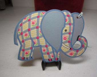 Adorable unused colorful die cut 1930's bridge tally elephant with a gingham pattern and pink roses