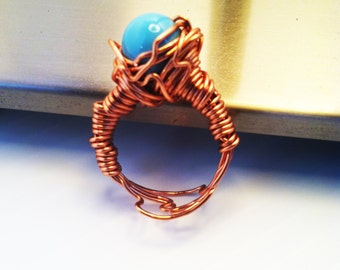1-Copper wire wrap sleeping Beauty turquoise  pearl ring. size 7- Meaning  protection.