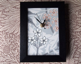 Jasmine wallpaper clock.  Framed clock featuring a piece of the William Morris and Co design, grey and neutral tones.