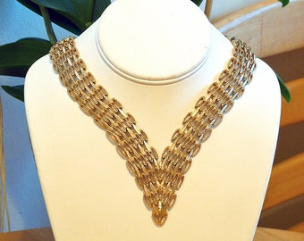 Monet woven florentined 12K plated statement piece necklace