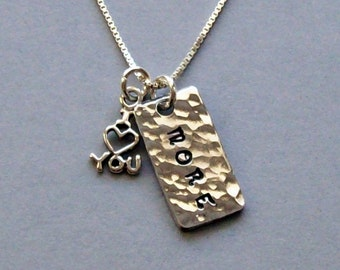 "I love you more pendant necklace of hammered solid aluminum with sterling silver ""I (heart) you"" charm on a sterling silver chain."