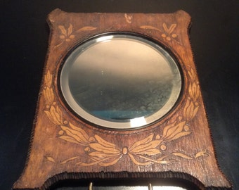 Antique pyrography frame with round bevelled mirror