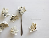 12 origami flowers . paper flower .  wedding flower favors . party flowers . books . book flower -book pages