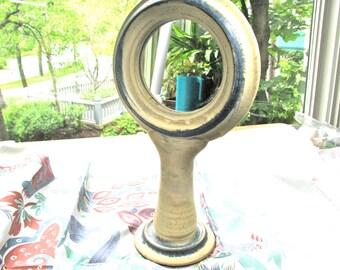 Handmade ceramic mirror, 12 inches high, 7 inch diameter, cream glaze with blue accents