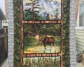 Reversible wildlife baby quilt