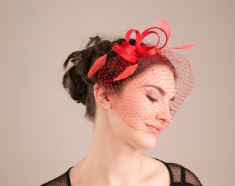 Bridesmaid millinery headpiece with feathers in poppy red