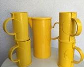 Vintage bright yellow pitcher 4 mugs set Dansk Gourmet plastic