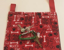 Pooch Pouch, red dog bone print, coordinated lining