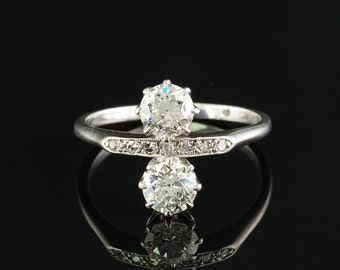 A rare Edwardian twin diamond platinum ring