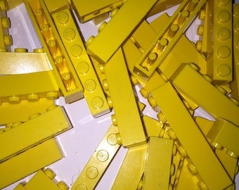 25 yellow 1x6 LEGO bricks!