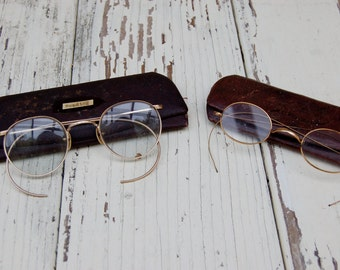 Vintage eye glasses choose one. spectacles Wire framed eyeglasses with leather cases. Pacific Optical Co eye wear. Osgood Optical Co.