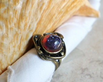 Dragons breath glass opal ring in antique bronze floral setting.