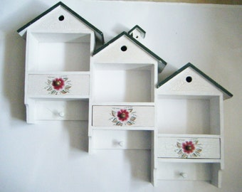 Adorable Wood Shelf Rack For Walls With Drawers And Spaces For Nic Nacks And Pegs To Hang Keys
