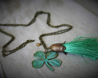 Fiona Necklace: long antique brass necklace with patina 4-leaf clover and green tassel