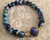 Multi color beaded bracelet with gunmetal pave bar bead