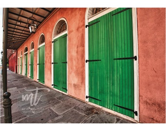 Bright Green Doors on French Quarter Building in New Orleans