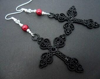 A pair of long black metal  cross & red glass pearl bead   earrings.