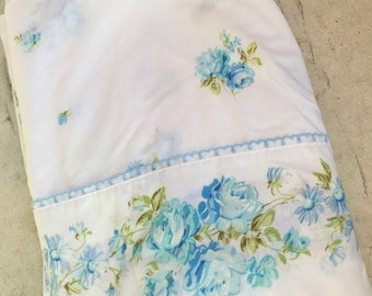 Vintage Twin Flat Sheet, with blue flowers.