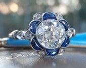 Exquisite Vintage Sapphire and Diamond Flower Cluster Engagement Ring. 1 Carat Old Brilliant Cut Diamond. Platinum. Elegant, Ornate, Bliss!