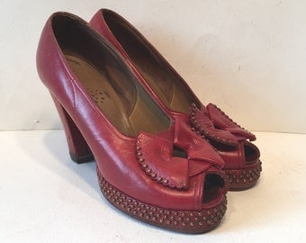 size 6.5 / 1940s red leather studded platforms with bows