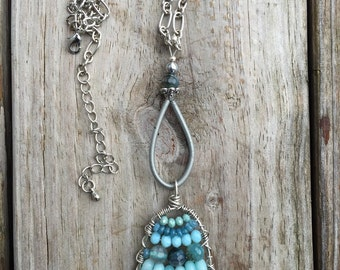 Wire wrapped beaded pendant necklace.