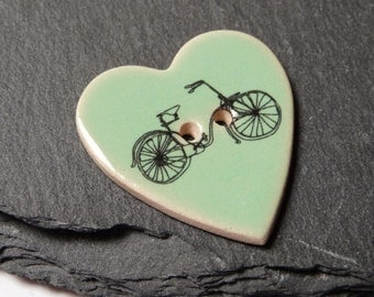 Ceramic Button Heart Shaped Mint Green With Bicycle Print 28mm Wide