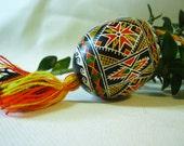 Traditional pysanka - Ukrainian easter egg - folk motifs