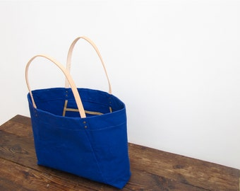 Sale now 25% off. Large Blue Angular Tote in washed canvas and thick leather straps. Extra large and super sturdy.