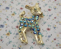 A gorgeous large Bambi baby deer vintage jewelry brooch made in goldtone metal set with sparkly blue aurora borealis faceted paste stones
