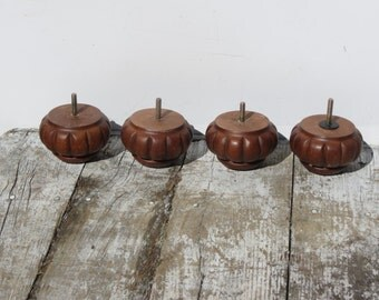 Set of Four Carved Mahogany Bun Feet