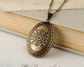 Antique Locket necklace Oval shaped with Moroccan patterns in Antique bronze vintage Carved Two pictures keepsake with bronze chain
