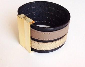 black sand/gold leathercuff