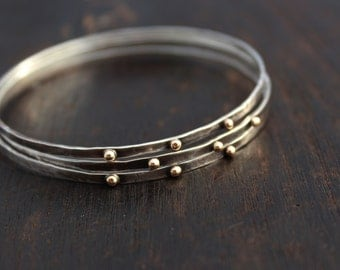 Silver and gold bangle. Silver and gold bracelet. Hammered sterling silver bangle with gold dots. Rustic blackened bangles Gold and silver.