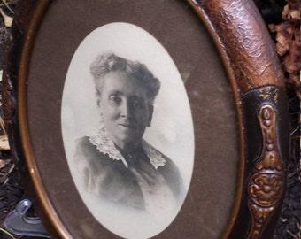 Vintage 20's framed oval photograph