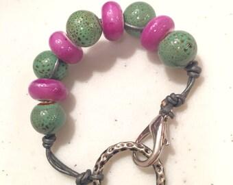 Ceramic beads and leather bracelet.