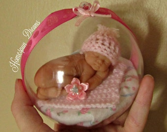 Beautiful Christmas Ornament of Sleeping Baby, comes in pink, blue and white, perfect for baby's first Christmas memento/nursery display!