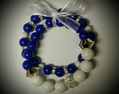 """Arm Candy. """"Purity"""" Royal Blue and White Zeta Phi Beta inspired stretch bracelet."""