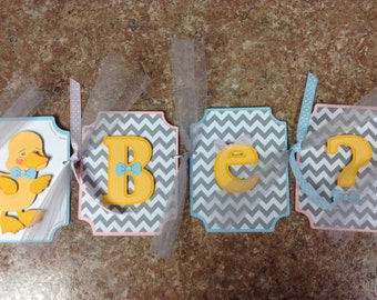 Waddle It Be Gender Reveal Banner in baby blue and baby pink