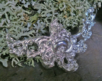 Silver Plated Stamping Roccoco